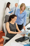 Businesswomen Discussing Document Royalty Free Stock Image
