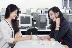 Businesswomen discussing with financial chart Royalty Free Stock Image