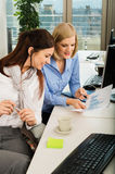 Businesswomen Discussing Graph In Office Royalty Free Stock Photo