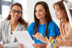 Businesswomen discussing papers at office Royalty Free Stock Photography