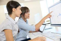 Businesswomen discussing strategy Stock Photos