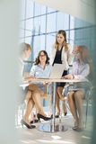 Businesswomen discussing at table in office Stock Photo