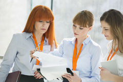 Businesswomen doing paperwork in office Stock Photo