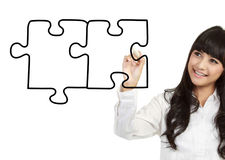 Businesswomen drawing puzzle Royalty Free Stock Photos