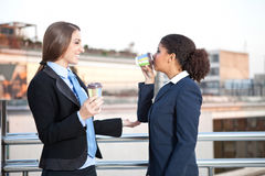 Businesswomen drinking coffee, time for coffee Stock Photos