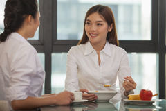 Businesswomen eating breakfast Stock Photo