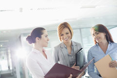 Businesswomen with file folders discussing in office Royalty Free Stock Image
