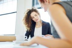 Businesswomen during finance analysis Stock Image