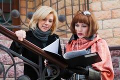 Two fashion businesswomen with financial folder Stock Photo
