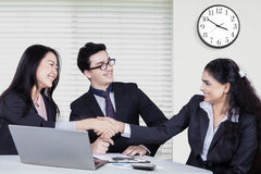 Businesswomen finishing up a meeting by shaking hands Stock Photos