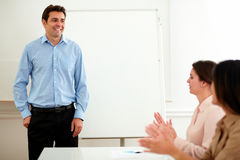 Businesswomen giving applause in a conference Stock Photo