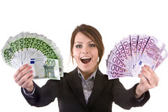 Businesswomen with group of money. Royalty Free Stock Photos