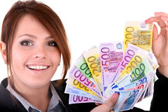 Businesswomen with group of money. Royalty Free Stock Photography
