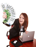 Businesswomen with group of money and laptop. Royalty Free Stock Image