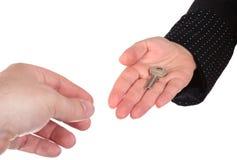 Businesswomen handing over the key Royalty Free Stock Image
