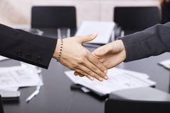 Businesswomen handshake over table Royalty Free Stock Images