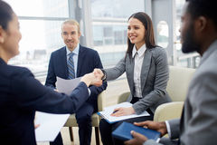 Businesswomen handshaking Stock Photo