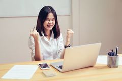 Businesswomen are happy to succeed in work, and show document on the table in offiec background.  royalty free stock images