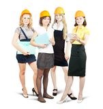 Businesswomen in hard hat with documents Royalty Free Stock Photos