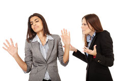 Businesswomen having an argument. Portrait of two businesswomen having an argument isolated on white background Royalty Free Stock Image