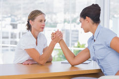 Businesswomen having an arm wrestle Stock Images