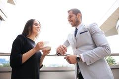 Businesswomen having break on office terrace outdoor drinking coffee talking. Stock Photography