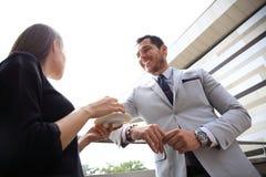 Businesswomen having break on office terrace outdoor drinking coffee talking. Royalty Free Stock Photos