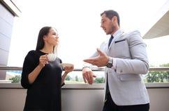Businesswomen having break on office terrace outdoor drinking coffee talking. Royalty Free Stock Images