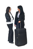 Businesswomen having conversation before travel Stock Image