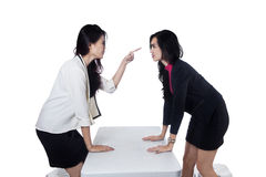 Businesswomen having a fight. Two business women having a fight - isolated on white background royalty free stock images