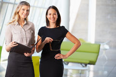 Businesswomen Having Informal Meeting In Modern Office Royalty Free Stock Photo