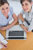 Businesswomen having a meeting and smiling up at camera Royalty Free Stock Photos