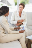 Businesswomen having a meeting to go over figures on the couch Royalty Free Stock Photo