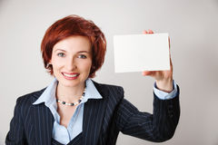 Businesswomen holding a business card. Woman holds out business card. Focus on hand and card Stock Image