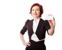 Businesswomen holding a business card. Woman holds out business card. Focus on hand and card Royalty Free Stock Images