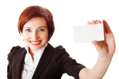Businesswomen holding a business card. Woman holds out business card. Focus on hand and card Stock Photo