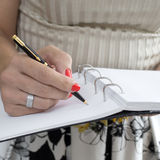 Businesswomen  holding a clipboard and write on it Royalty Free Stock Photos