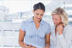 Businesswomen holding digital tablet Stock Photo