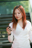 businesswomen holding mobile phone on stair Royalty Free Stock Image