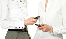 Businesswomen holding mobile phones Stock Photo