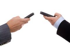 Businesswomen holding mobile phones Stock Photo