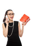 Businesswomen holding notebook talking on the phone Royalty Free Stock Photos
