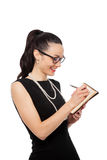 Businesswomen holding orange notebook and writing Stock Images