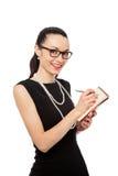 Businesswomen holding orange notebook and writing Stock Photos