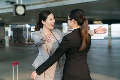 Businesswomen hugging each other. royalty free stock image