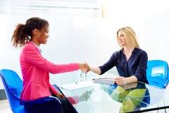 Businesswomen interview handshake multi ethnic Stock Photo