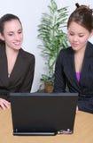 Businesswomen with laptop Stock Photos