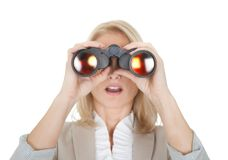 Businesswomen looking through binoculars Stock Photos