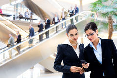 Businesswomen looking at cellphone Stock Photo