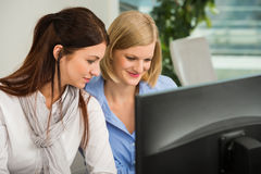 Businesswomen Looking At Computer Monitor Royalty Free Stock Images